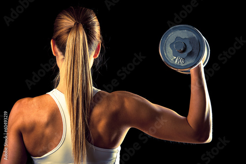 Láminas  Fitness girl - attractive young woman working out with dumbbells