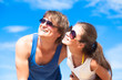Closeup of happy young couple in sunglasses smiling