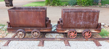 Rusted Old Mining Carriages Filled With Stones