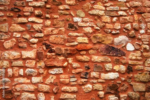 Texture Mur ocre en pierres sèches