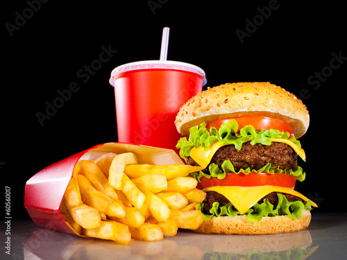 Tasty hamburger and french fries on a dark Poster