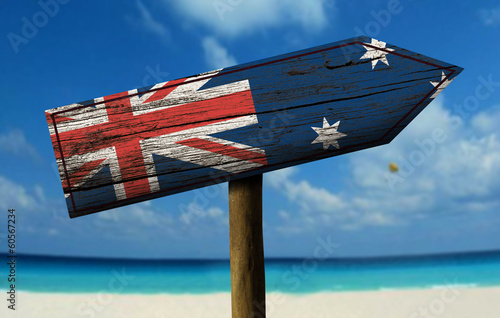 Fotobehang Australië Australia flag wooden sign with a beach on background