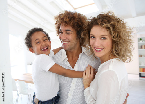 Happy family standing in brand new home Canvas-taulu