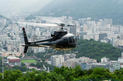 Poster Helicopter Excursion helicopter taking off and Botafogo in Rio de Janeiro