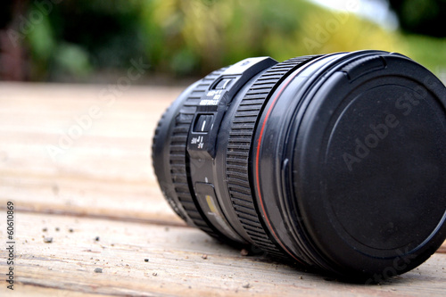 Photo Camera lens on the wood floor