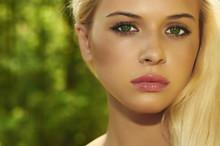 Beautiful Blond Woman In Forest.Summer Sunlight.Green Eyes