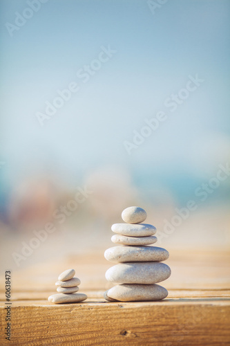 Garden Poster Zen zen stones jy wooden banch on the beach near sea. Outdoor