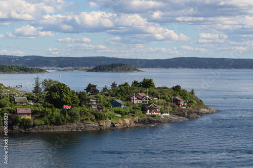 Houses on an island in the Oslo fjord, Norway Poster