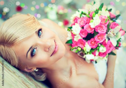 Fotografie, Obraz  Beautiful blonde bride with a bouquet of flowers
