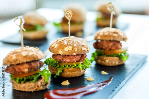 Fotografie, Obraz  Multiple min beef hamburgers.