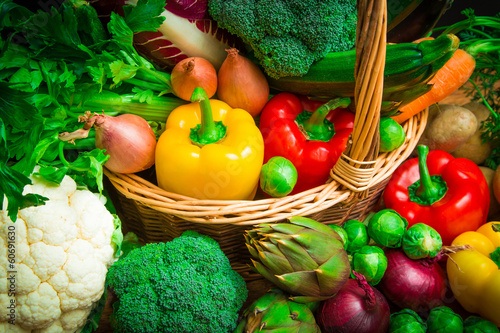 Fotografia  mix of season vegetables in wicker basket