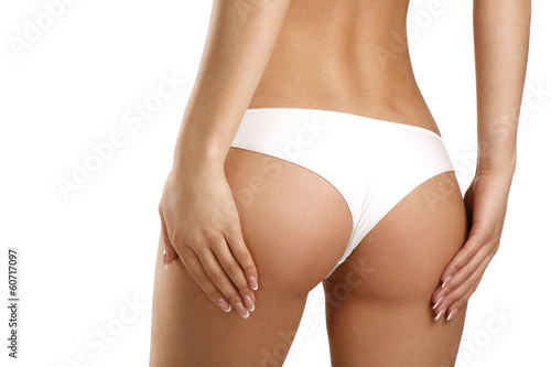 Closeup of a beautiful woman showing perfect buttocks