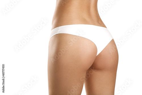 Fotografie, Obraz  Closeup of a beautiful woman showing perfect buttocks