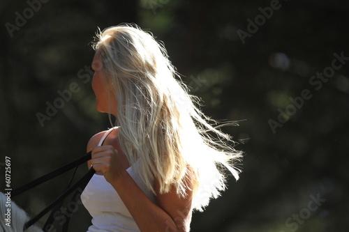 Blonde Reiterin - von hinten Stock-Foto | Adobe Stock