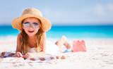 Fototapeta See - Adorable little girl at beach