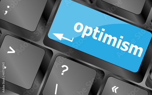 Fotografia  optimism button on the keyboard close-up