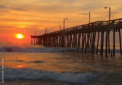Fotografie, Obraz  Sunrise by a fishing pier in North Carolina