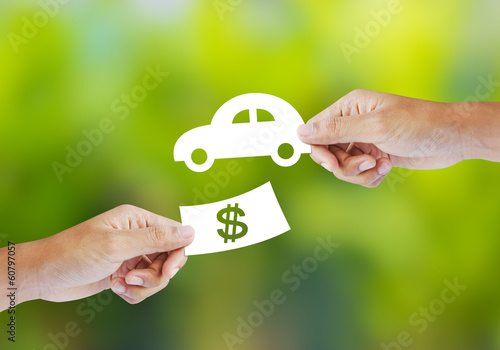 Hand with paper money and car shape. new car buy concept Canvas Print