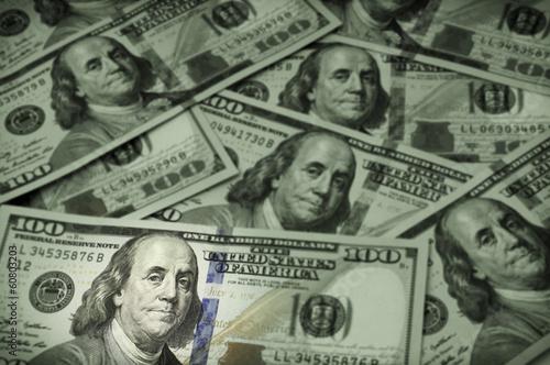 Fotografie, Obraz  One hundred dollar bills, focus on Benjamin Franklin