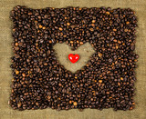 Little heart on coffee beans