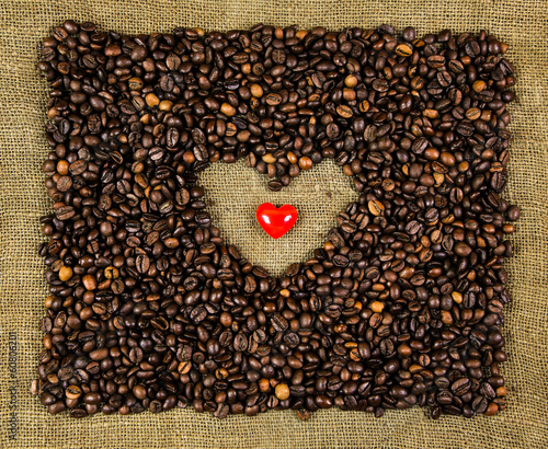 Little heart on coffee beans