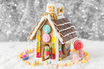 A candy coated gingerbread house in a Christmas display