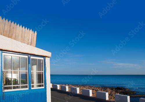 Denia Las Rotas blue house in Mediterranean sea Poster
