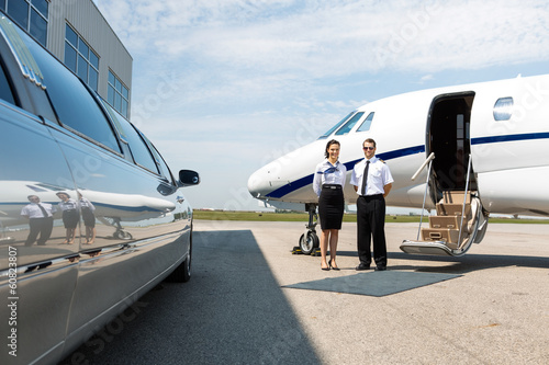 Flight Attendant And Pilot Neat Limousine And Private Jet Wallpaper Mural