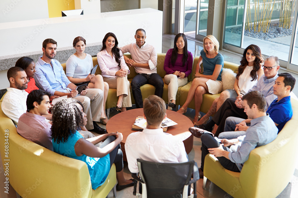 Fototapeta Multi-Cultural Office Staff Sitting Having Meeting Together