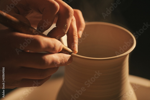 Hands working on pottery wheel ,  retro style toned