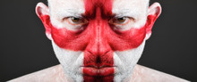 Man With His Face Painted With The Flag Of England.