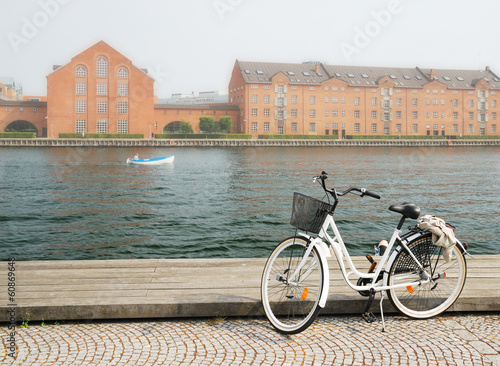 Bicycle loading on wharf of canal in Copenhagen Wallpaper Mural