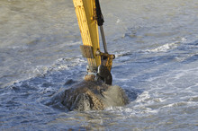 Dredging Harbor With Excavator