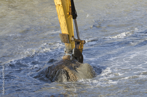 Valokuvatapetti Dredging harbor with excavator