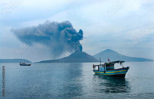 Fotobehang Indonesië Boat near Anak Krakatau. Volcano eruption. Indonesia