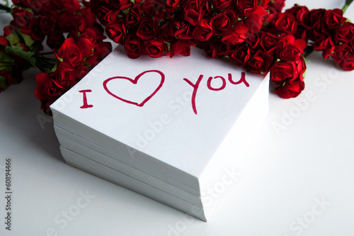 Photo notebook with marker inscription I love you and roses