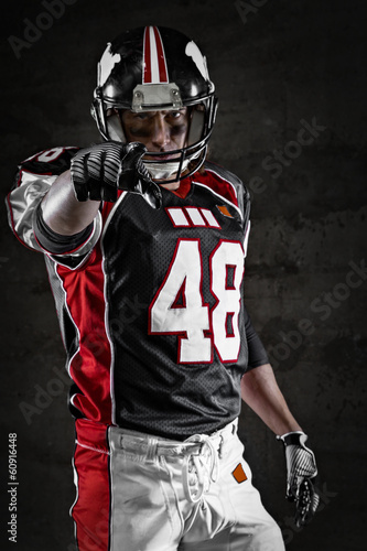 Fotografie, Obraz  American footballer pointing at you