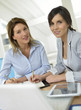 Businesswomen working together on project