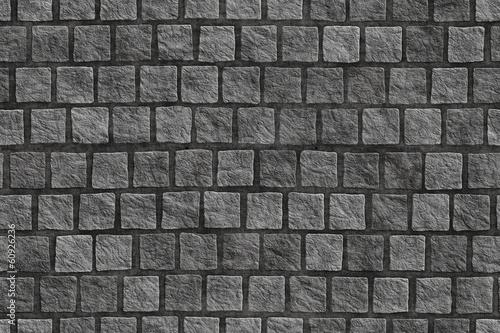 Cuadros en Lienzo Granite cobblestoned pavement background.