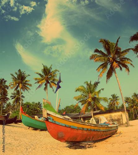 Fototapeta old fishing boats on beach - vintage retro style