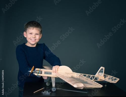 Happy boy with model plane.