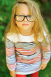Sweet little girl wearing glasses - outdoor