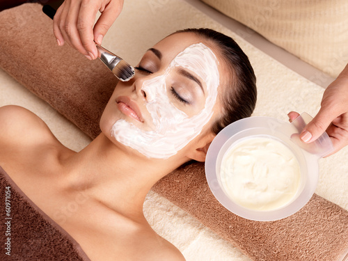 Spa therapy for woman receiving facial mask Tablou Canvas