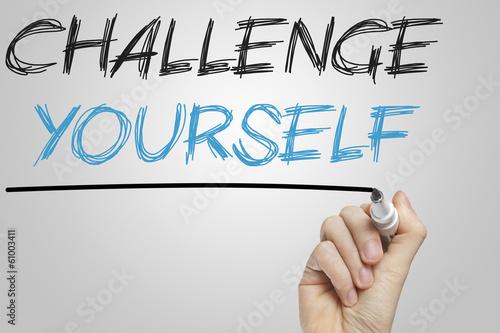 Fotografia  Challenge yourself written on a whiteboard
