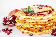 Crisp Golden Fresh Baked Waffle Topped With Pomegranate