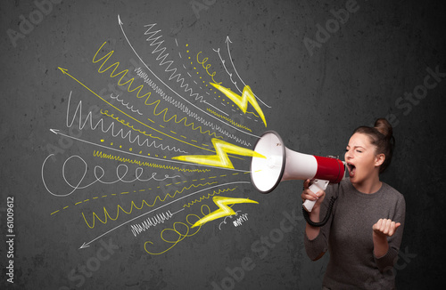 Fotografía Cute girl shouting into megaphone with hand drawn lines and arro