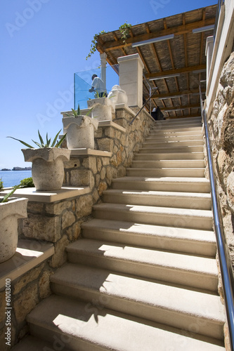 Stone stairway from hotel terrace to the beach