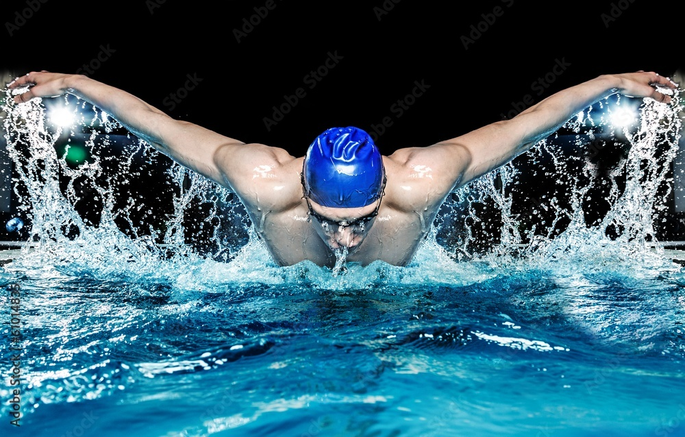 Fototapety, obrazy: Muscular young man in blue cap in swimming pool