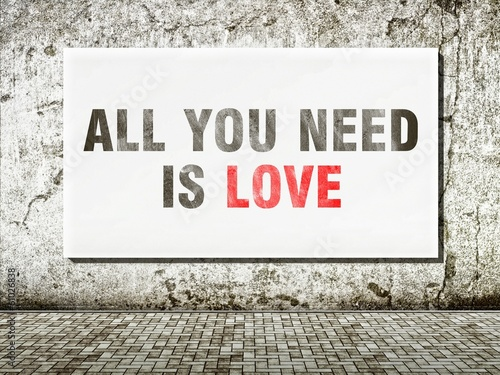 Photo  All you need is love, words on wall
