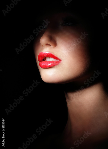 Photo  Woman with Red Lips in Shadows. Spotlight